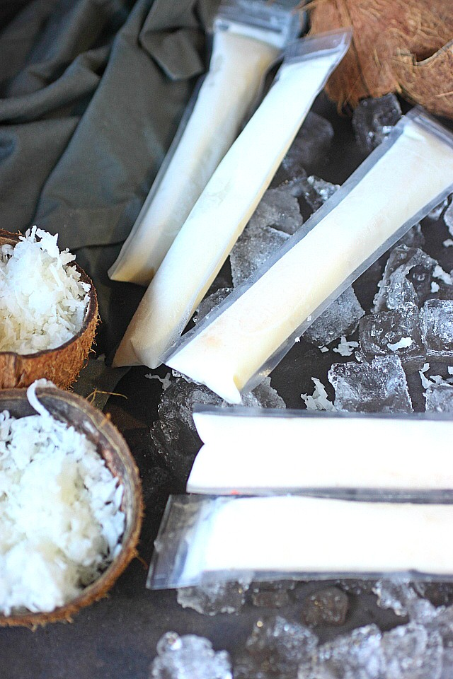 A bunch of Coconut Rum Pops --- www.mind-over-batter.com